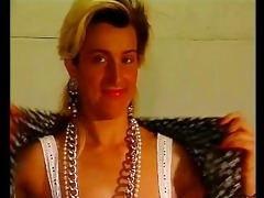 hot blond disrobes and poses for the camera