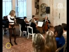 hot blond disrobes to classical music