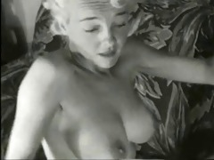 1950s blond pin-up beauty lounging