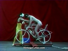 beautiful gal is riding a sex-bike