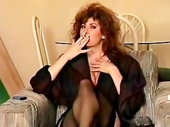 classic 80s smoking, big hair and all