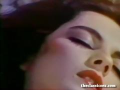 breasty retro chick masturbates in ottoman