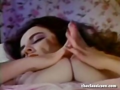 breasty retro babe masturbates in sofa