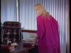 vintage scene of a hot blonde getting a head with